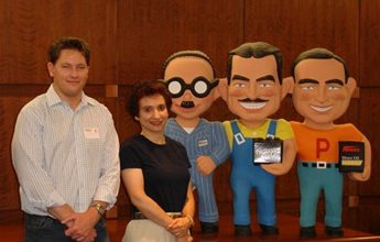 "During a break in the production of ""Modern Marvels: Auto Stores"" for The History Channel, CorporateHistory.net president Marian Calabro posed with program producer Scott Goldie and Pep Boys mascots Manny, Moe, and Jack."
