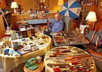 """""""Once a Sandviker, always a Sandviker."""" Bill Lindberg, a retired materials and analysis engineer, posed for us at his home """"museum"""" containing Sandvik axes, files, wrenches, knives, golf clubs, pliers, pruners, handsaws, power saw blades, and other items. (Photo by Guy Cali Associates, Clarks Summit, PA)"""